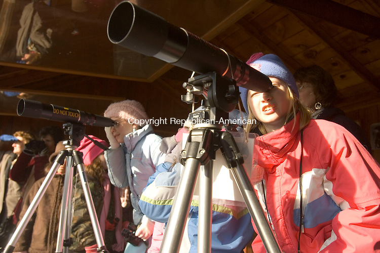SOUTHBURY, CT- 13 JANUARY 2008-011308JS05--Grace Kais, right, and Jane Mafale, both members of the Girl Scout Troop 33259 in Fairfield, look through spotting scopes at bald eagles Sunday at the Shepaug Eagle Observation Area at the Shepaug Dam in Southbury. The girls were earning their wildlilfe badge.  <br /> Jim Shannon / Republican-American