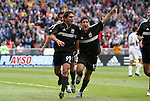 3 April 2004: Jaime Moreno (99), Alecko Eskandarian (11),  and Ryan Nelsen (rear) celebrate after Moreno's goal in the 12th minute had given DC United a 1-0 lead. DC United defeated the San Jose Earthquakes 2-1 at RFK Stadium in Washington, DC on opening day of the regular season in a Major League Soccer game...