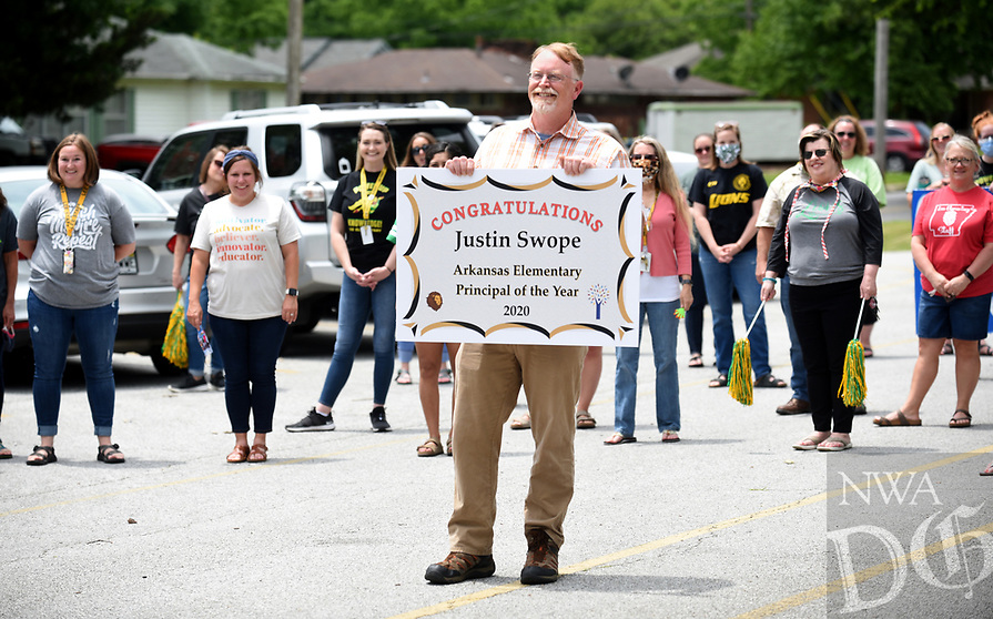 Lee Elementary School principal Justin Swope is photographed Thursday, May 21, 2020, with a group of well wishers made up of teachers, staff and administrators at the school in Springdale. Swope was recognized as the Arkansas Elementary Principal of the Year 2020 by the Arkansas Association of Elementary School Principals. Swope has been the principal at Lee Elementary School for nine years. Check out nwaonline.com/200522Daily/ and nwadg.com/photos for a photo gallery.<br /> (NWA Democrat-Gazette/David Gottschalk)