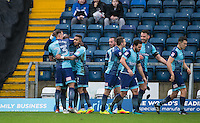 Celebrations as Adebayo Akinfenwa of Wycombe Wanderers scores the first goal during the Sky Bet League 2 match between Wycombe Wanderers and Crawley Town at Adams Park, High Wycombe, England on 25 February 2017. Photo by Andy Rowland / PRiME Media Images.