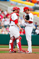 Michael Blazek (33) of the Springfield Cardinals stands on the mound with Charles Cutler (37) during a game against the Arkansas Travelers on May 10, 2011 at Hammons Field in Springfield, Missouri.  Photo By David Welker/Four Seam Images.