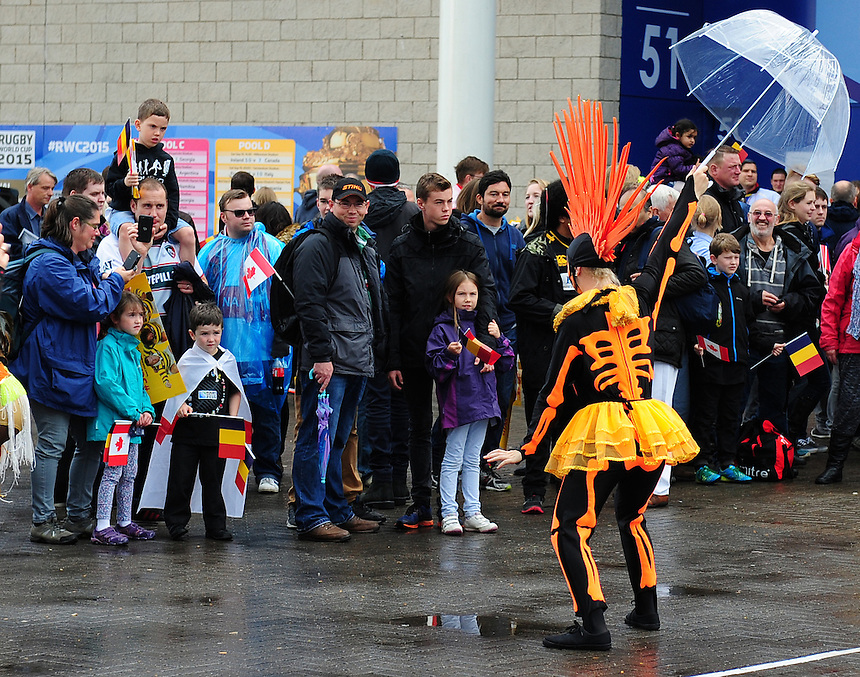 Spectators watch entertainers perform outside the King Power Stadium, Leicester, ahead of the game between Canada and Romania<br /> <br /> Photographer Chris Vaughan/CameraSport<br /> <br /> Rugby Union - 2015 Rugby World Cup Pool D - Canada v Romania - Tuesday 6th October 2015 - King Power Stadium, Leicester <br /> <br /> &copy; CameraSport - 43 Linden Ave. Countesthorpe. Leicester. England. LE8 5PG - Tel: +44 (0) 116 277 4147 - admin@camerasport.com - www.camerasport.com