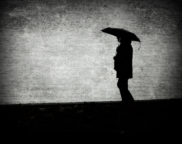 A person carrying an umbrella
