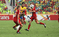 Brazil's Boquita (18) moves the ball past Germany's Lewis Holtby (10) during the FIFA Under 20 World Cup Quarter-final match at the Cairo International Stadium in Cairo, Egypt, on October 10, 2009. Germany lost 2-1 in overtime play.
