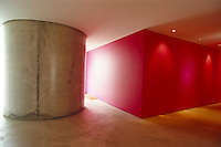 The architect has used colour and shape in this concrete entrance hall