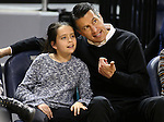 Nevada Gov. Brian Sandoval and his daughter Marisa, 10, watch the college basketball game between UNLV and Nevada in Reno, Nev., on Tuesday, Jan. 27, 2015. The Rebels won 67-62. (Las Vegas Review-Journal/Cathleen Allison)