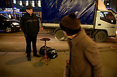 A man sells a table on the street in central Moscow. .Picture by Justin Jin.