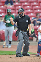 Home plate umpire Nick Susie calls a strike during a game between the Cedar Rapids Kernels and the Beloit Snappers at Veterans Memorial Stadium on April 9, 2017 in Cedar Rapids, Iowa.  The Kernels won 6-1.  (Dennis Hubbard/Four Seam Images)