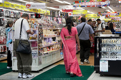 Foreign visitors shop in Akihabara district area on May 20, 2015, Tokyo, Japan. According to figures from the Japan National Tourism Office a total of 1,764,700 million foreigners visited Japan in April, up 43.3% from the same period last year. (Photo by Rodrigo Reyes Marin/AFLO)