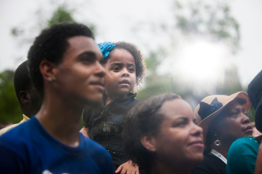 Supporters listen as U.S. President Barack Obama speaks in the rain during a campaign rally in Glen Allen, Virginia