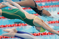 16 MAR 2006 - MELBOURNE, AUSTRALIA - Stephanie Rice (AUS) dives into the water at the start of her 200m Individual Medley heat at the 2006 Commonwealth Games. (PHOTO (C) NIGEL FARROW)