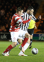 Steven Thompson tackled by Jon Routledge in the St Mirren v Hamilton Academical Scottish Communities League Cup match played at St Mirren Park, Paisley on 25.9.12.
