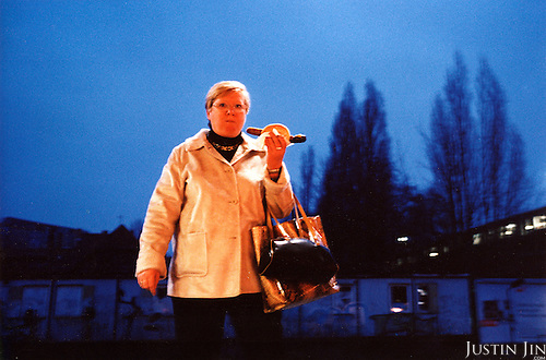 A German woman eats a giant sausage in Berlin's Ostkreuze metro station..Picture taken 2005 by Justin Jin
