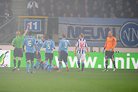 VOETBAL: HEERENVEEN: Abe Lenstra Stadion, SC Heerenveen - Ajax, 11-01-2012, Eindstand 0-5, scheidsrechter Kevin Blom geeft SC Heerenveen keeper Brian Vandenbussche (#25) de rode kaart wegens een overtreding op Siem de Jong (#10 | op de grond), Theo Janssen (#16), Vurnon Anita (#5), Christian Eriksen (#8), Doke Schmidt (#36), ©foto Martin de Jong