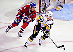 14 December 2009: Buffalo Sabres defenseman Andrej Sekera is pursued by Montreal Canadiens center Scott Gomez during the first period at the Bell Centre in Montreal, Quebec, Canada. The Sabres defeated the Canadiens 4-3. Mandatory Credit: Ed Wolfstein Photo