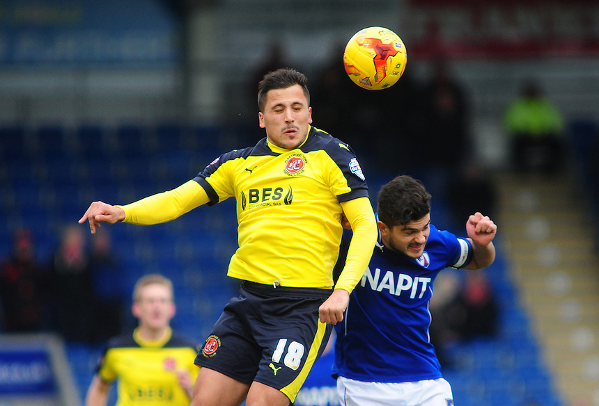 Fleetwood Town's Antoni Sarcevic vies for possession with Chesterfield's Sam Morsy<br /> <br /> Photographer Chris Vaughan/CameraSport<br /> <br /> Football - The Football League Sky Bet League One - Chesterfield v Fleetwood Town - Saturday 28th February 2015 - Proact Stadium - Chesterfield<br /> <br /> &copy; CameraSport - 43 Linden Ave. Countesthorpe. Leicester. England. LE8 5PG - Tel: +44 (0) 116 277 4147 - admin@camerasport.com - www.camerasport.com