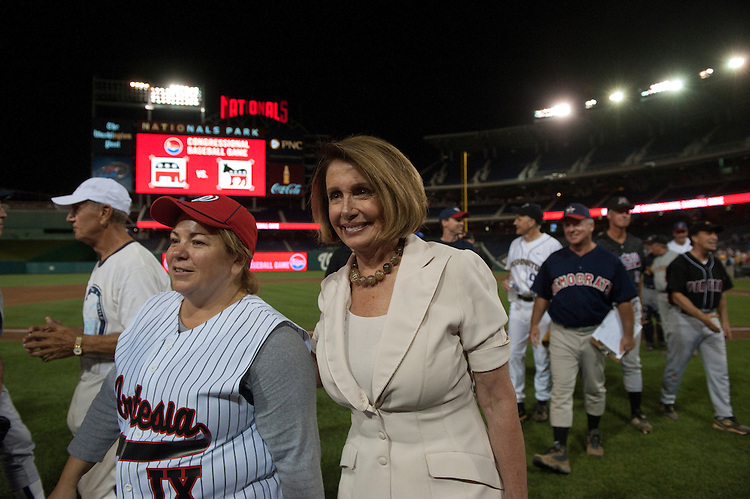 UNITED STATES - JULY 14: Linda Sanchez, D-CA., and Nancy Pelosi, D-CA., at the 50th Annual Roll Call Congressional Baseball Game held at Nationals Stadium, July 14, 2011.(Photo By Douglas Graham/Roll Call)