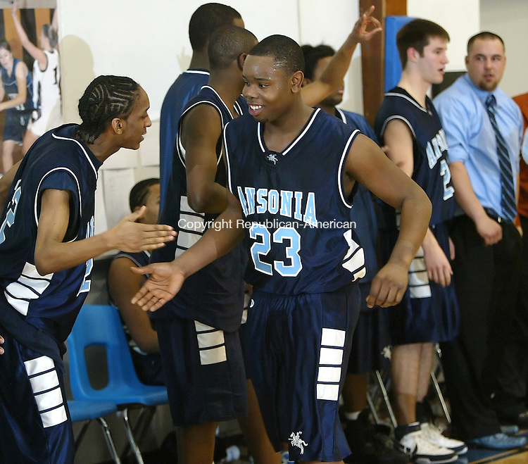 Litchfield, CT-030308MK012 Ansonia's # 23 Sheldon Clarke and his teammates celebrate their victory at the Boys Class S Tournament 1st round action at Litchfield High School Monday evening.  The Chargers defeated the Cowboys 70 - 60 in a game that had several lead changes. Michael Kabelka / Republican-( Ansonia's # 23 Sheldon Clarke )CQ