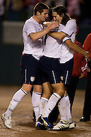 The USA's Sacha Kljestan (16, right) hugs Brian Ching (11) as teammate Kenny Cooper (27, left) joins in after they celebrate Kljestan's 3rd goal of the game.  The USA Men's National team beat the Sweden 3-2  at the Home Depot Center in Carson, Calif on Saturday, January 24, 2009.