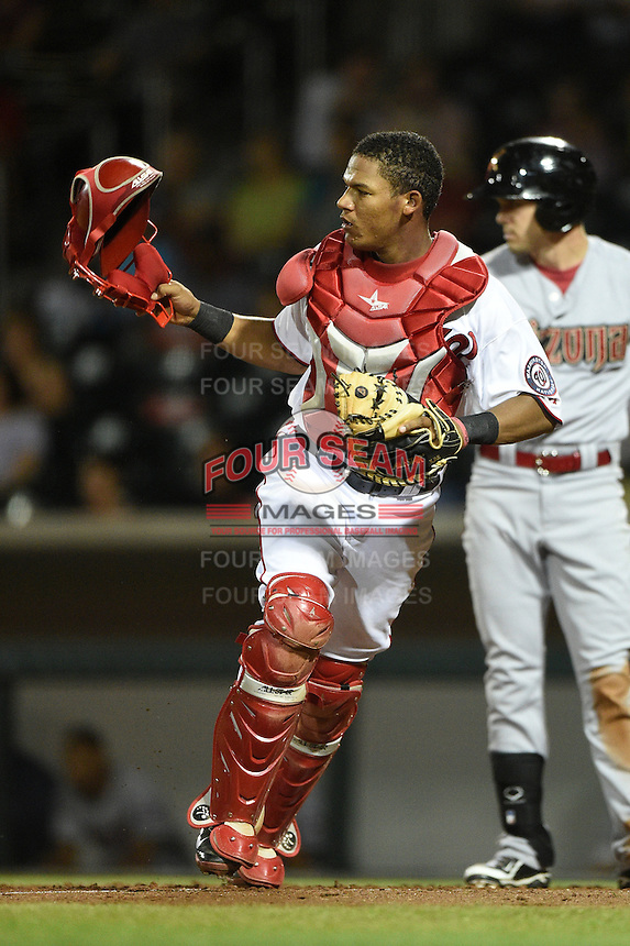 Mesa Solar Sox catcher Pedro Severino (14) during an Arizona Fall League game against the Salt River Rafters on October 18, 2014 at Cubs Park in Mesa, Arizona.  Mesa defeated Salt River 8-4.  (Mike Janes/Four Seam Images)