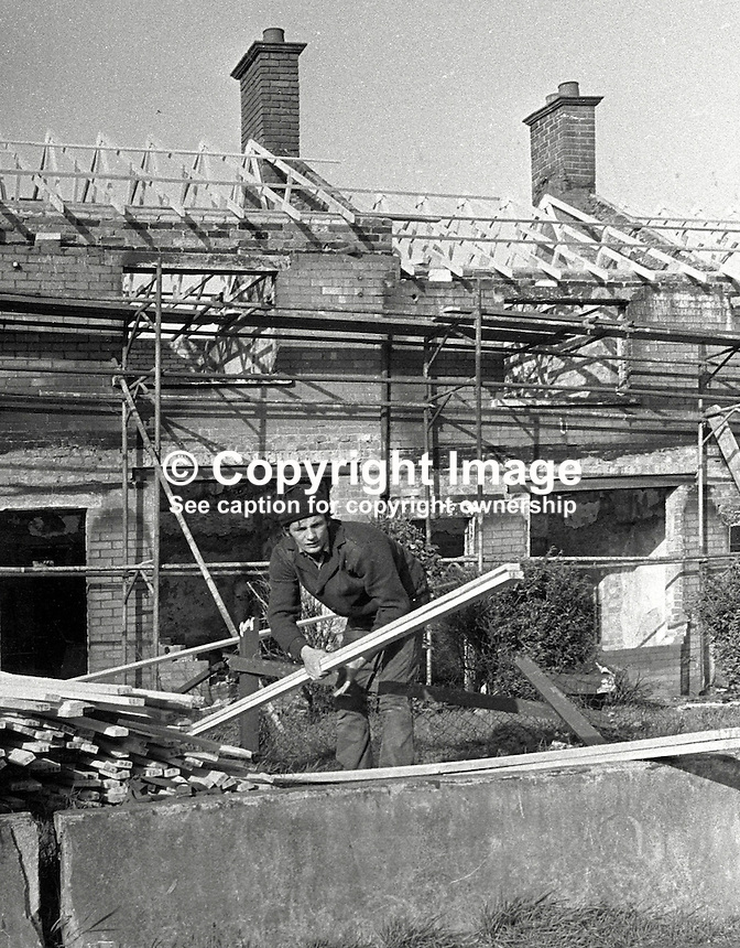 Roman Catholics are rebuilding and making habitable again houses at Farringdon Gardens, Ardoyne, Belfast, which were evacuated and in many cases set on fire by fleeing Protestants who left the area following post-Internment rioting. Date that photos were taken is uncertain but probably 3 or 4 months after the rioting in August 1971. 426/71, 197111000426b..Copyright Image from Victor Patterson, 54 Dorchester Park, Belfast, UK, BT9 6RJ..Tel: +44 28 9066 1296.Mob: +44 7802 353836.Voicemail +44 20 8816 7153.Skype: victorpattersonbelfast.Email: victorpatterson@mac.com.Email: victorpatterson@ireland.com (back-up)..IMPORTANT: If you wish to use this image or any other of my images please go to www.victorpatterson.com and click on the Terms & Conditions. Then contact me by email or phone with the reference number(s) of the image(s) concerned.