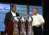Safety Sean Taylor, left, and Head Coach Joe Gibbs, right, at a Redskin Park press conference in Ashburn, Virginia introducing Taylor as the Washington Redskins' number one pick in the 2004 NFL draft  on April 26, 2004. .Credit: Arnie Sachs / CNP...