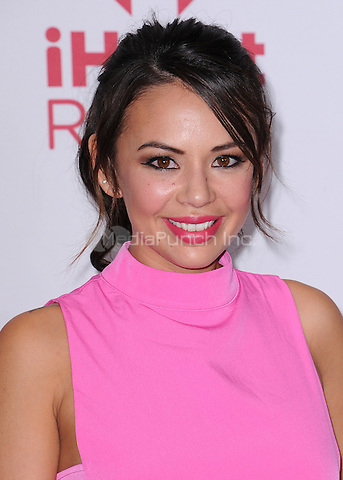 LAS VEGAS, NV - SEPTEMBER 19:  Janel Parrish at the 2014 iHeartRadio Music Festival at the MGM Grand Garden Arena on September 19, 2014 in Las Vegas, Nevada. PGSK/MediaPunch