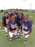 Virginia football runningbacks fight for the top spot on the team August 24, 2010. Credit Image: © Andrew Shurtleff