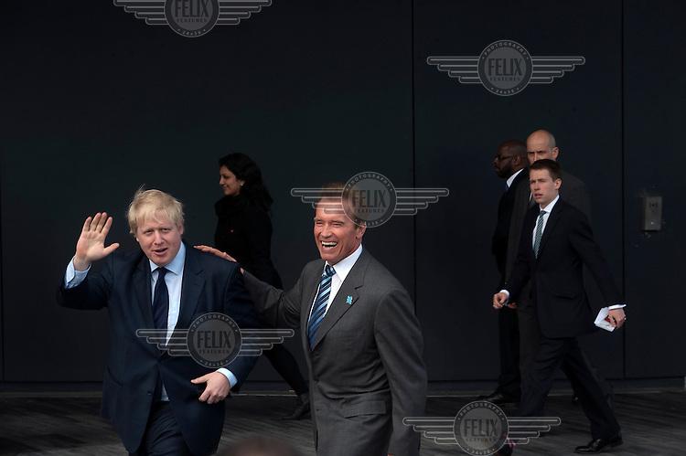 Arnold Schwarzenegger and Mayor of London Boris Johnson at City Hall in London.