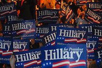 The crowd at Monona Terrace waves signs for Hillary Clinton Monday night
