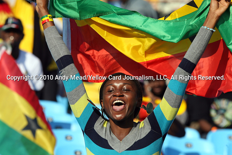 13 JUN 2010:  Ghana fan in the stands waving her country's flag.  The Serbia National Team played the Ghana National Team at Loftus Versfeld Stadium in Tshwane/Pretoria, South Africa in a 2010 FIFA World Cup Group D match.