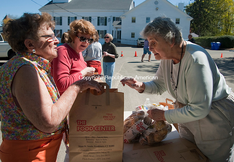 WATERTOWN, CT 01 MAY 2013--050113JS01-Volunteers Phyllis Schaar, center, and Irene Franson, right, help out Lucille Houseknecht of Thomaston, left, as she picks up items from the Connecticut Food Bank's mobile food pantry Wednesday at the First Congregational Church in Watertown. The mobile pantry, which distributes food in 24 locations throughout the state, will be at the church the first Wednesday of every month from 2 p.m. to 3 p.m. Anyone interested in volunteering to help distribute the food can call the church at 860-274-6737 or Watertown Social Services at 860-945-5252. The pantry needs 15 volunteers every month. .Jim Shannon Republican-American.