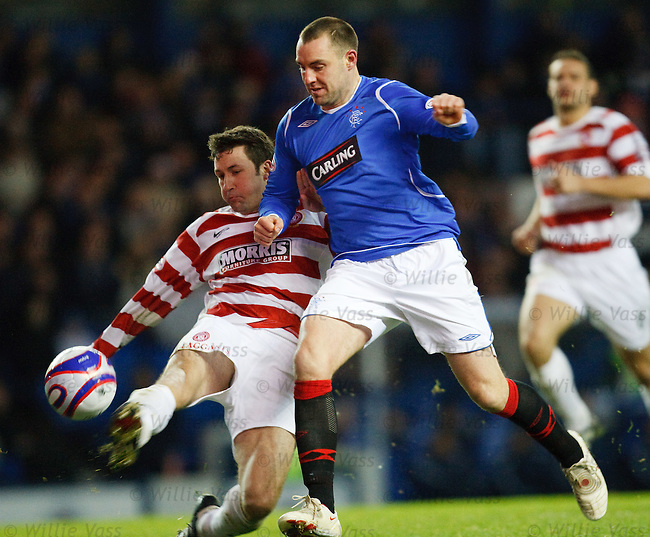 Kris Boyd taken down by Martin Canning's challenge for a penalty and a red card