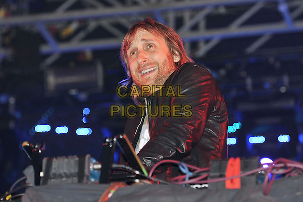 David Guetta.Performs on during Day One of Wireless Festival, Hyde Park, London, England, UK, 1st July 2011..half length music live on stage concert gig dj-ing dj   black leather jacket smiling beard facial hair .CAP/MAR.© Martin Harris/Capital Pictures.