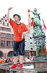 21 June 2006: A Holland fan encourages others to join him in the fountain in Frankfurt's town square. The Netherlands played Argentina at Commerzbank Arena in Frankfurt, Germany in match 37, a Group C first round game, of the 2006 FIFA World Cup.