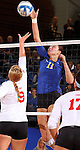 BROOKINGS, SD - OCTOBER 5:  Wagner Larson #11 from South Dakota State University tries to get a kill past Tori Kroll #9 from the University of South Dakota in the third game of their match Saturday night at Frost Arena. (Photo by Dave Eggen/Inertia)