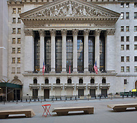 New York Stock Exchange, designed by George B Post in Neoclassical style, and built in 1903, at 11 Wall St, Lower Manhattan, New York, New York, USA. The facade of the building features 2 square corner pillars and 6 columns with Corinthian capitals. The pediment features a sculptural scene by John Quincy Adams Ward entitled Integrity Protecting the Works of Man. Picture by Manuel Cohen