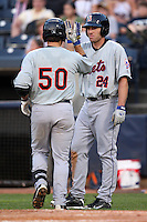 Binghamton Mets Catcher Mike Nickeas (50) is greeted by Nick Evans (24) after hitting a home run during a game vs. the Akron Aeros at Eastwood Field in Akron, Ohio;  June 25, 2010.   Binghamton defeated Akron 5-3.  Photo By Mike Janes/Four Seam Images