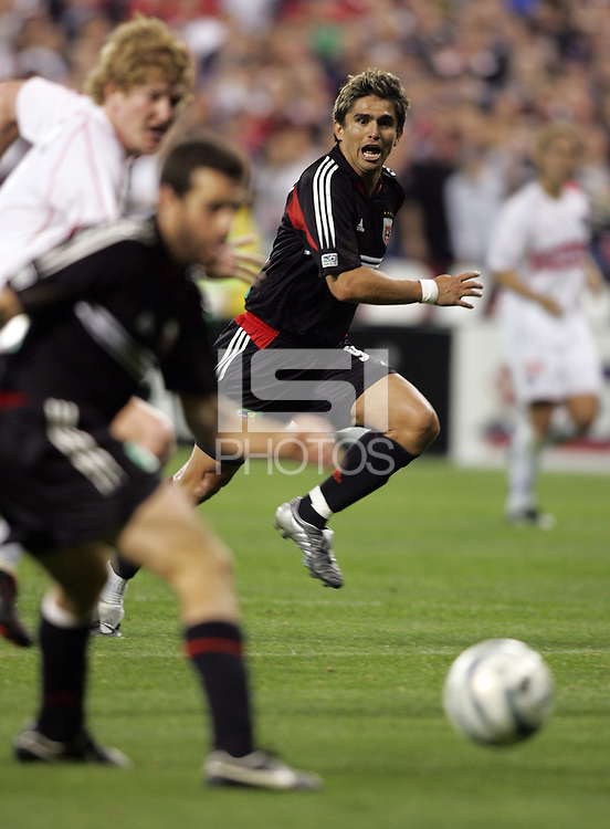 9 April 2005.  Jaime Moreno (99, far) calls for the ball to be passed to him from teammate Ben Olsen (14) at RFK Stadium in Washington, DC.