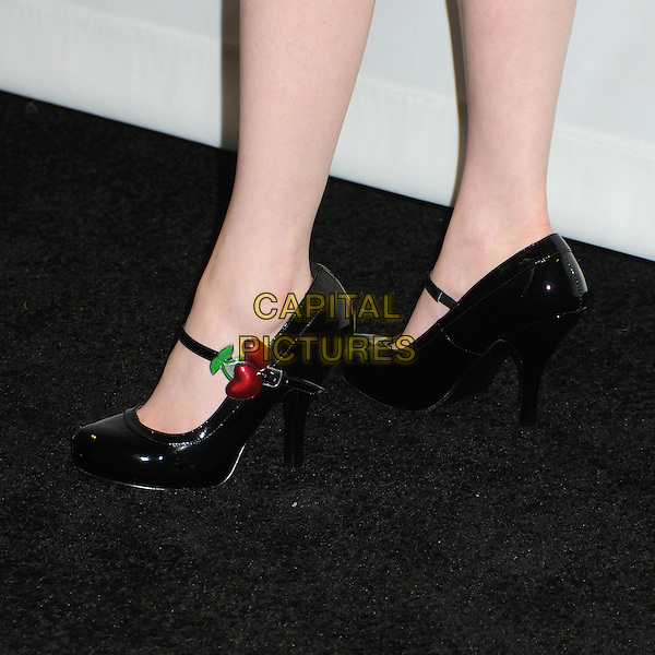 """Molly Quinn's shoes .PaleyFest 2012 Presents """"Castle"""" held at The Saban Theatre, Beverly Hills, California, USA, 9th March 2012..detail black patent shoes mary janes cherries .CAP/ADM/BP.©Byron Purvis/AdMedia/Capital Pictures."""