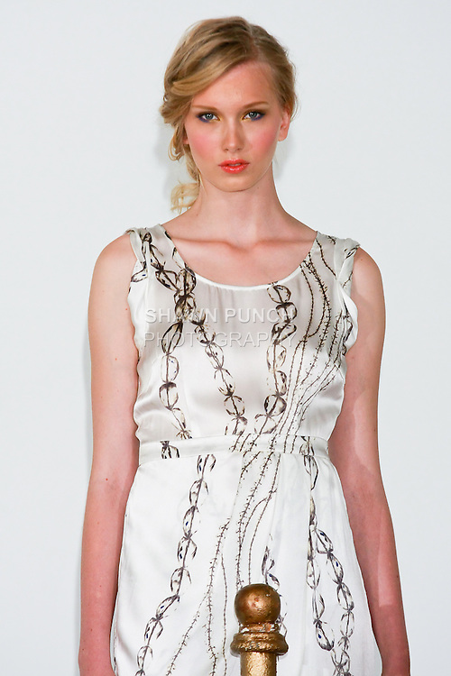 "Model poses in a rolled sleeve dress by Grace Sun, for the Grace Sun Spring Summer 2011 ""Soft Armor"" collection presentation; October 20, 2010."