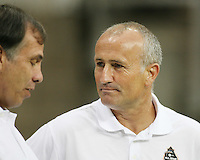 Dominic Kinnear of the MLS All-Stars talks to Bruce Arena during the 2010 MLS All-Star match against Manchester United at Reliant Stadium, on July 28 2010, in Houston, Texas. Manchester United won 5-2.