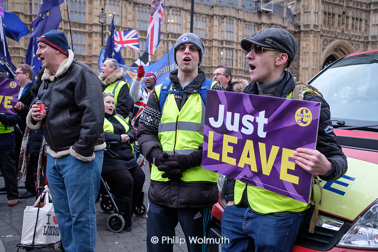 Just Leave.  Brexit supporters demonstrate outside the Houses of Parliament as MPs vote on amendments to Theresa May's withdrawal deal with the EU.  Westminster, London.