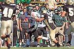 Palos Verdes, CA 10/08/10 - Kevin McMahon  (South #13) and Logan Okuda (Peninsula #25) in action during the South Torrance Spartans vs Peninsula Panthers Varsity football game at Palos Verdes Peninsula High School.