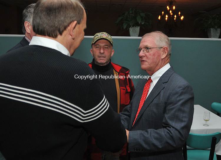 MIDDDLEBURY, CT 08 NOVEMBER 2011--110811JS13---Middlebury First Selectman elect, Ed St. John, right, receives congratulations by Middlebury residents John Polmon and Ned Love during a post election gathering at Junipers Restaurant in Middlebury on Tuesday.  r<br /> Jim Shannon Republican-American