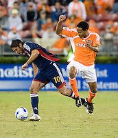 Houston Dynamo midfielder Ricardo Clark jumps over Chivas USA forward Juan Pablo Garcia.  Houston Dynamo beat CD Chivas USA 2-0 at Robertson Stadium in Houston, TX on October 29, 2006 to gain a berth in the Western Conference Final on a 3-2 aggregate.