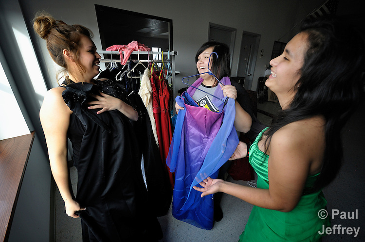 Girls try on prom dresses at the Cookson Hills Center, a ministry of The United Methodist Church in Cookson, Oklahoma, that provides special clothing and support to girls from poor families that want to attend their school proms. Discussing their wardrobe are Saray Silcox (left), Brittney Silcox, and Sierra Silcox.