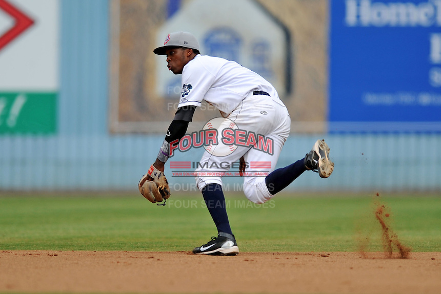 Asheville Tourists shortstop Rosell Herrera #7 fields a ball during game one of a double header against the Greensboro Grasshoppers on July 2, 2013 in Asheville, North Carolina.  The Tourists won the game 5-3. (Tony Farlow/Four Seam Images)