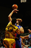 Kevin Owens steals a ball from Puke Lenden during game two of the NBL Final basketball match between the Wellington Saints and Waikato Pistons at TSB Bank Arena, Wellington, New Zealand on Friday 20 June 2008. Photo: Dave Lintott / lintottphoto.co.nz