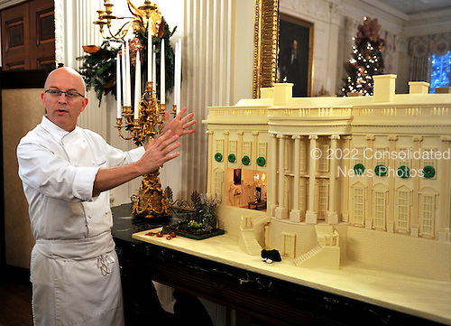 Washington, DC - December 2, 2009 -- The annual gingerbread house on display along the North wall of the State Dining Room.  It was designed and constructed by White House Pastry Chef Bill Yosses, left, and his team..Credit: Ron Sachs / CNP.(RESTRICTION: NO New York or New Jersey Newspapers or newspapers within a 75 mile radius of New York City)